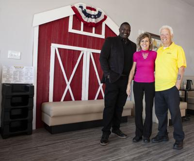 Lloyd Melton, right, and his partners, Charles Stewart and Erica Stewart, have just opened a new Biscuits near Club West.