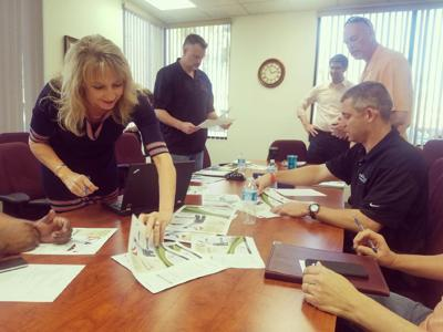 Golf committee members finalize the upcoming Ahwatukee Chamber of Commerce golf tournament on April 28th