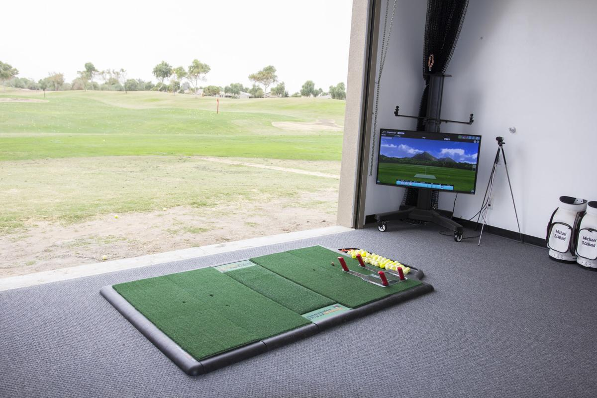 The indoor driving range helps golfers adjust their swings at different positions.