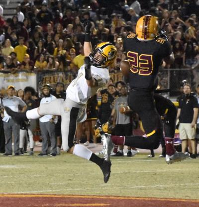 Pride defensive back Kenny Churchwell spoils a pass play by Gilbert during last Friday's game.