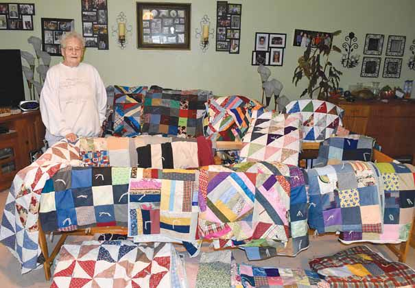 Lucille Kendall ties quilts for the homeless, needy