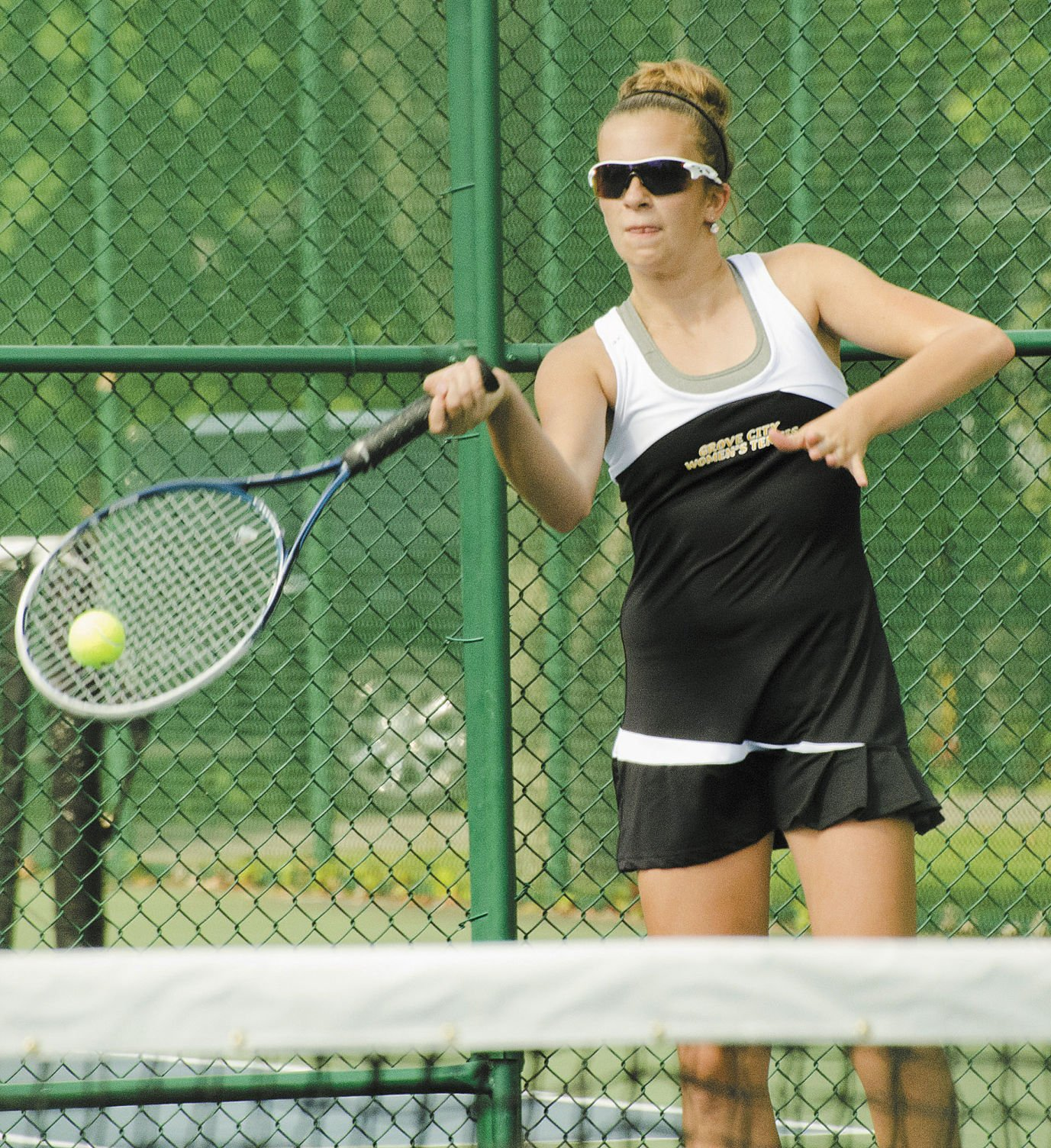 gaydek.net  8 Grove City's Emily Gordon returns a ball over the net in a match against  Sharon at Buhl Farm Park courts.