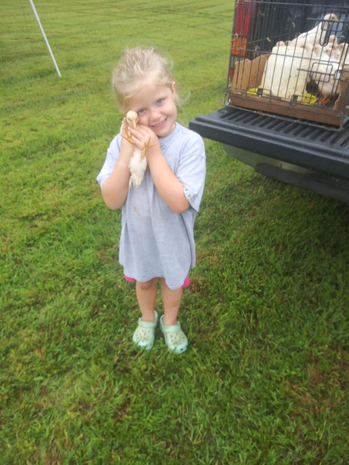 Eden Roman helps sell chickens