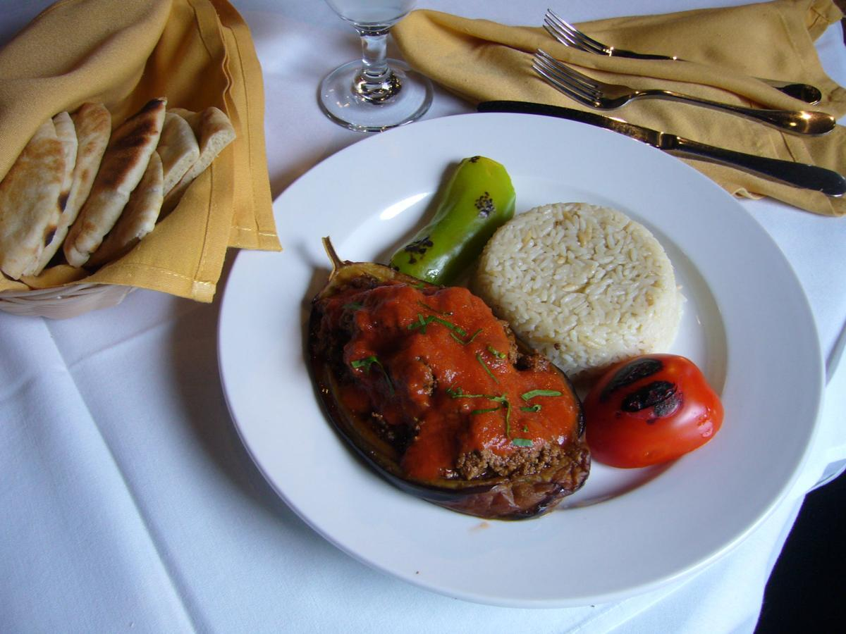 The Artemis' version of stuffing in the eggplant is a mix of ground beef and ground lamb, flavored and seasoned with tomatoes, green peppers and herbs.