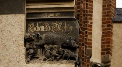"""Courtesy of JTA  The controversial """"Judensau, """"or """"Jew's Sow,"""" relief on the facade of the historic 14th-century Stadtkirche church in Wittenberg, Germany, where theologian Martin Luther once preached."""