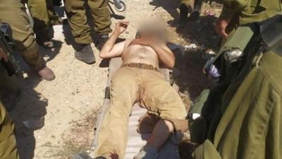 Courtesy of JNS; Photo credit: Yitzhar's Spokesperson's Office. A terrorist who attempted to attack Israeli soldiers near the settlement of Yitzhar, in Samaria, lies with a gunshot wound to his ankle.