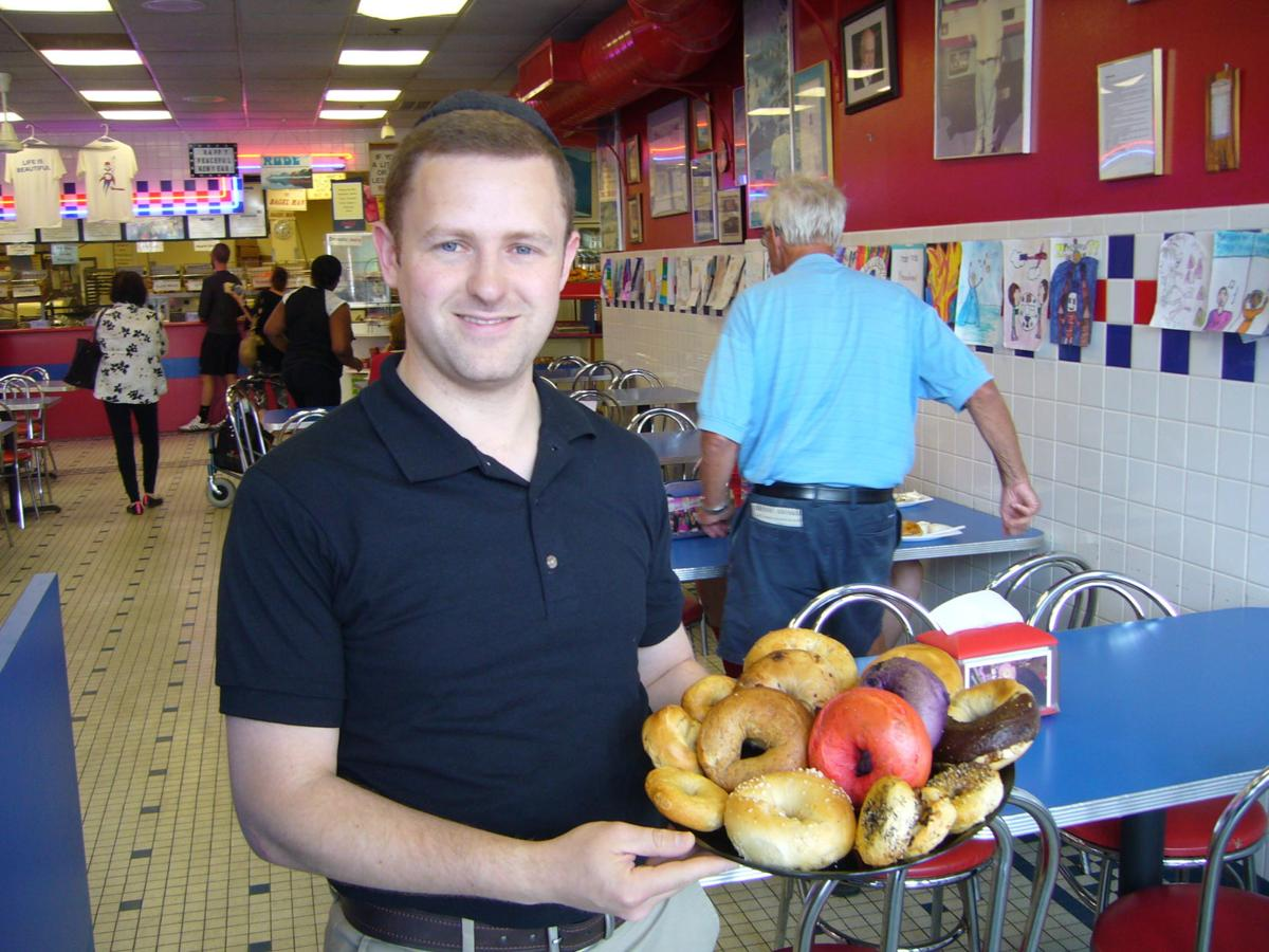 The new owner of Marx Hot Bagels, Y.Y. Davis with a plate of his bagels.
