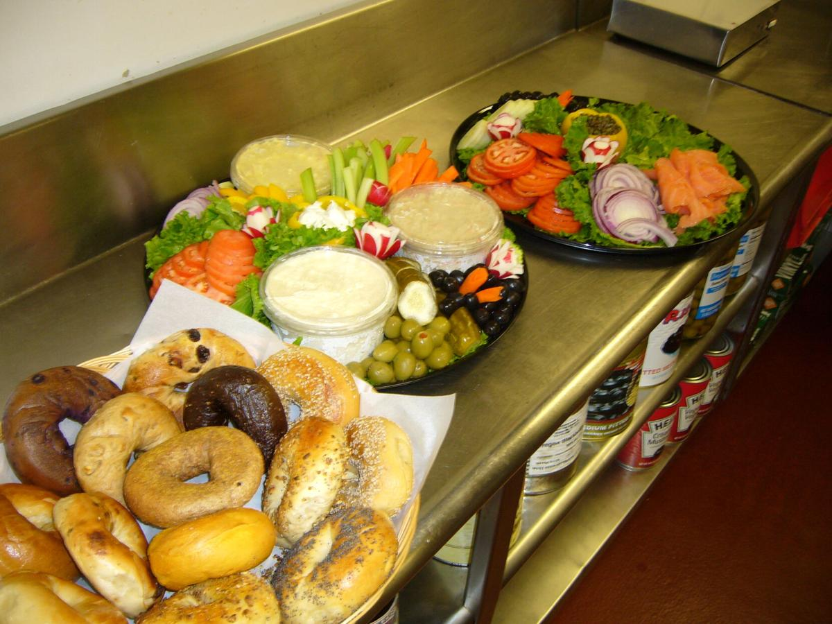 Trays of bagels, veggies, and spreads