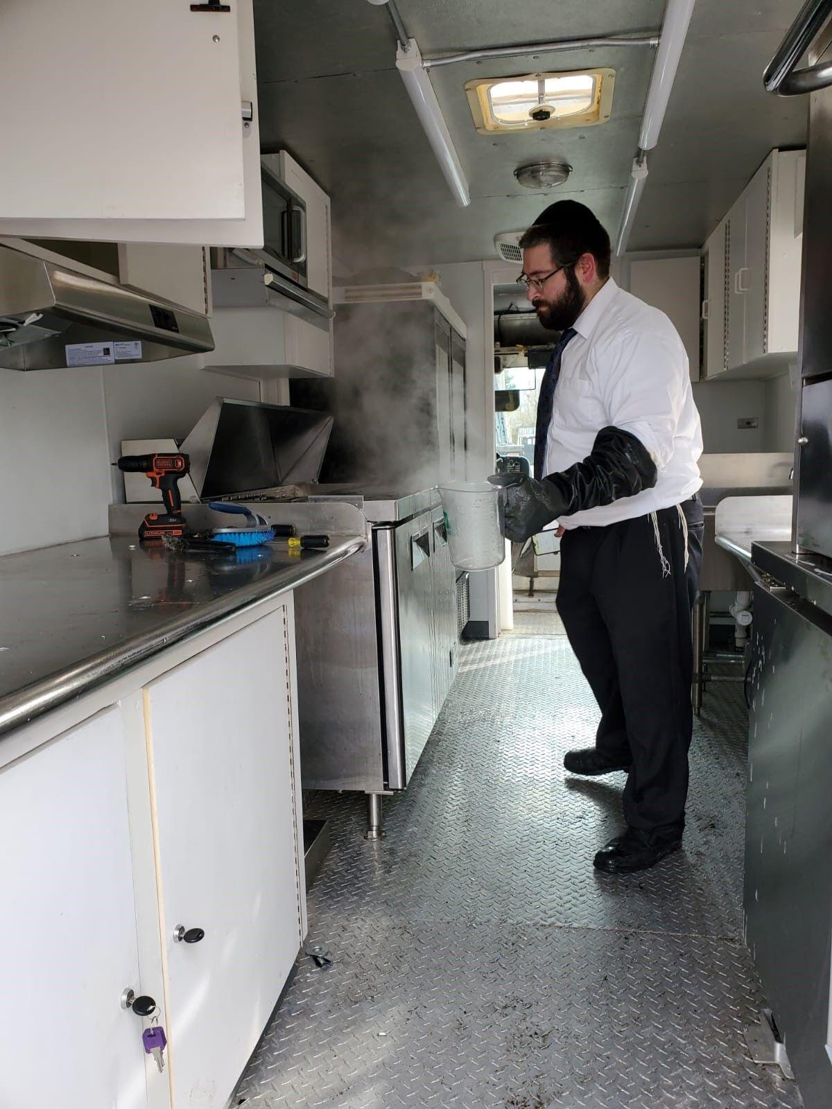 Rabbi Lazer Fisher inside the truck prior to kosher certification.