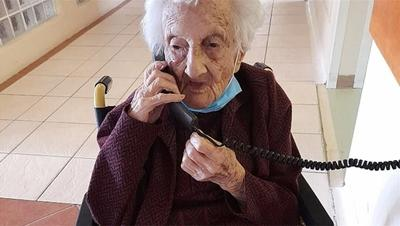 Courtesy of JTA Photo credit: David Wolpe   Rosalie Wolpe speaks to a relative on the phone on her 111th birthday at a retirement home in Cape Town, South Africa on Aug. 25, 2020.