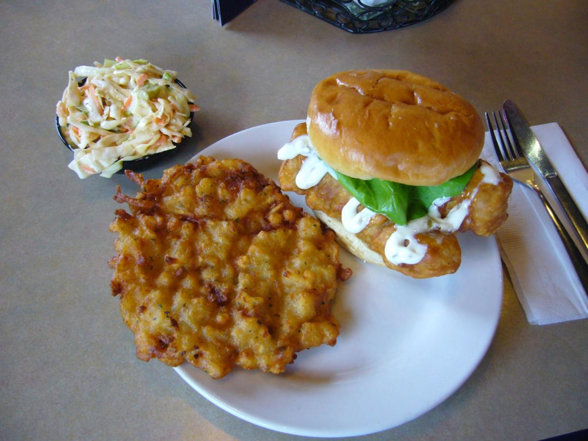 The Cod-father sandwich on a brioche bun, served with potato pancake and house-made cole slaw.