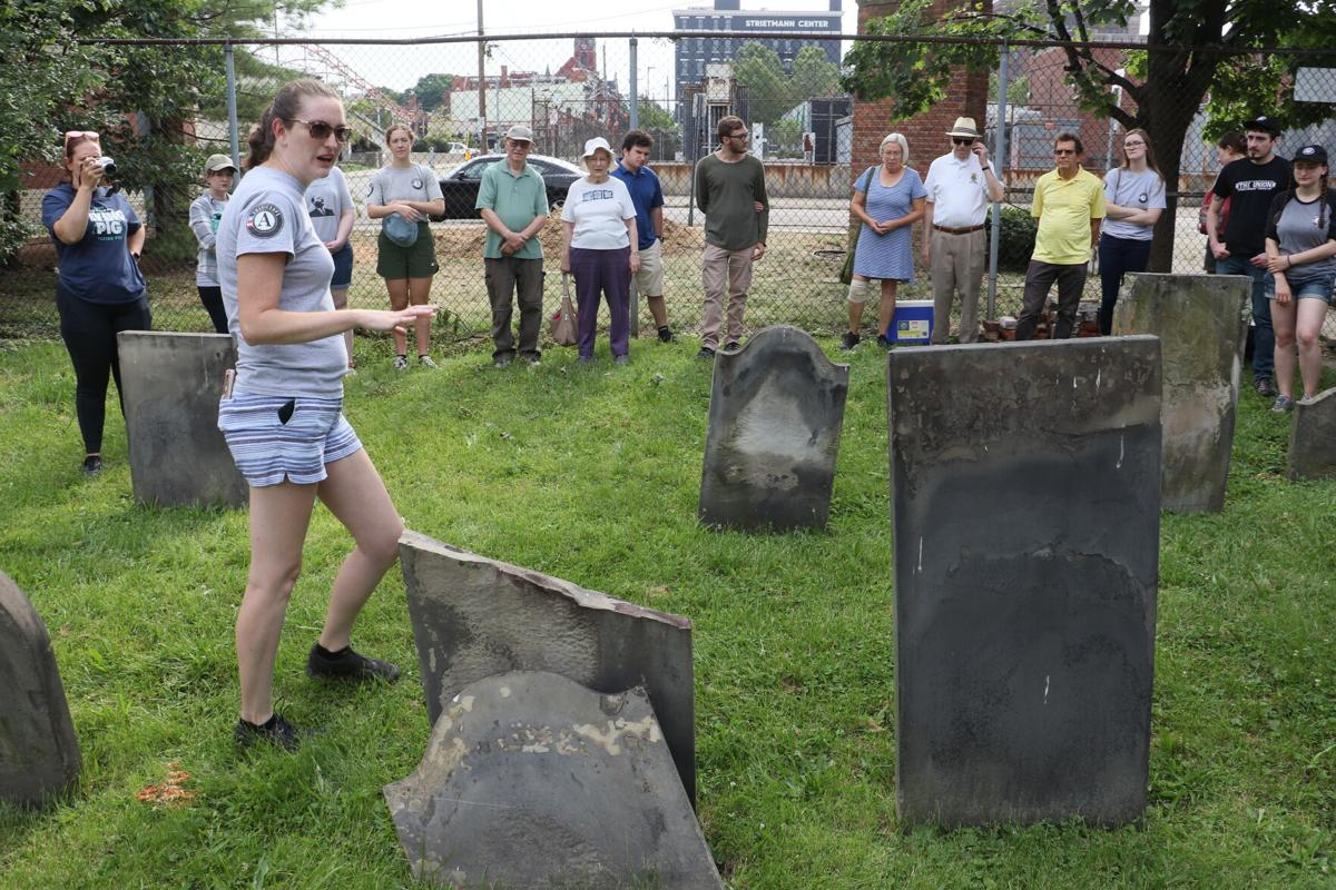 Carrie Rhodus, Community Surveyor for the Ohio History Service Corps, explains headstone preservation techniques to Service Corps volunteers and Jewish Cemetery of Greater Cincinnati board members and staff.