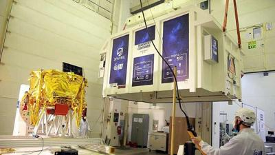 """Courtesy of Tomer Levi via JNS  The first Israeli lunar spacecraft (covered, at left), named """"Beresheet,"""" was loaded into a special shipping container on Jan. 17, 2019 in Israel to be flown to Florida ahead of SpaceIL's historic mission to the moon on Feb. 21, 2019."""