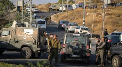Courtesy of Gershon Elinson/Flash90 via JTA  Israeli military and security forces search the area where an Israeli student, 19, was found stabbed to death in the West Bank. Aug. 8, 2019.
