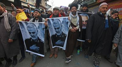 Courtesy of JTA  Kashmiri Shiite Muslims carry pictures of killed Iranian general Qassem Soleimani as they march during an anti-American protest in central Kashmir, Jan. 3, 2020.