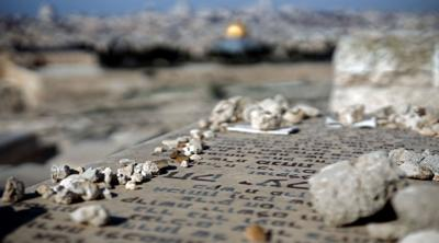 Courtesy of Thomas Coex/AFP/Getty Images via JTA  The Jewish cemetary of the Mount of Olives overlooks Jerusalem's Old City.