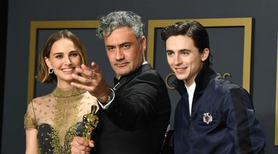 Courtesy of JTA  Jewish stars Natalie Portman, Taika Waititi, and Timothée Chalamet pose in the press room during the 92nd Annual Academy Awards