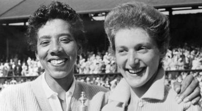 Courtesy of Getty Images via JTA Althea Gibson and Angela Buxton, right, celebrate winning the women's Wimbledon double's championship in 1956.