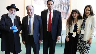Courtesy of Israel Mission to the U.N  via JNS  From left: Chabad of Poway Rabbi Yisroel Goldstein, U.N. Secretary General António Guterres, Israeli Ambassador to the United Nations Danny Danon, and Hannah Kaye and Randi Grossman (the daughter and sister of Lori Gilbert-Kaye, who was shot and killed in the Poway attack.)