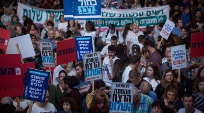"Courtesy of JTA Israelis attend a rally marking 24 years since the assassination of late Israeli Prime Minister Yitzhak Rabin, at Tel Avivs Rabin Square on Nov. 2, 2019, under the slogan: ""Yes to peace, no to violence."