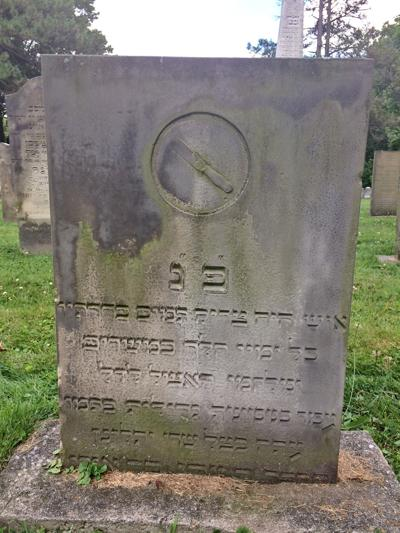 Symbol for a mohel on a monument in Jewish Cemeteries of Greater Cincinnati's Walnut Hills Cemetery.