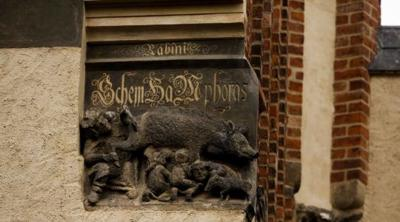 """Courtesy of JTA Photo credit: Carsten Koall   The controversial """"Judensau, """"or """"Jew's Sow,"""" relief on the facade of the historic 14th-century Stadtkirche church in Wittenberg, Germany, where theologian Martin Luther once preached."""
