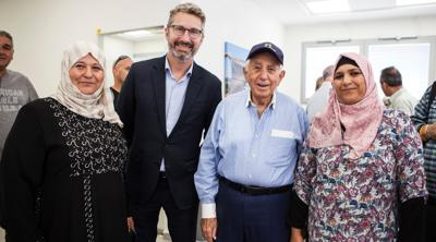 Courtesy of JTA Harry Triguboff, in cap,and Australian Ambassador to Israel Chris Cannan with Bedouin women who benefit from the Switch Center.
