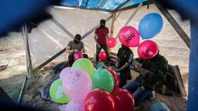 Courtesy of Hassan Jedi/Flash90 via JNS  Palestinians prepare balloons that will be attached to flammable material to be launched into Israel from the Gaza Strip, on June 25, 2019.