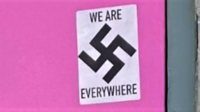 """Courtesy of JNS; Photo credit: Anchorage Police Department. Swastika stickers found on the Alaska Jewish Museum and """"Mad Myrna's"""" bar on May 26, 2021."""