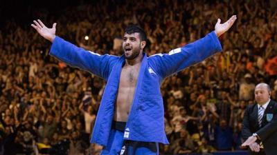 Courtesy of Roy Alima via JNS.   Israel's Sagi Muki celebrates after winning gold in the men's heavyweight category during the European Judo Championship in Tel Aviv on April 27, 2018.