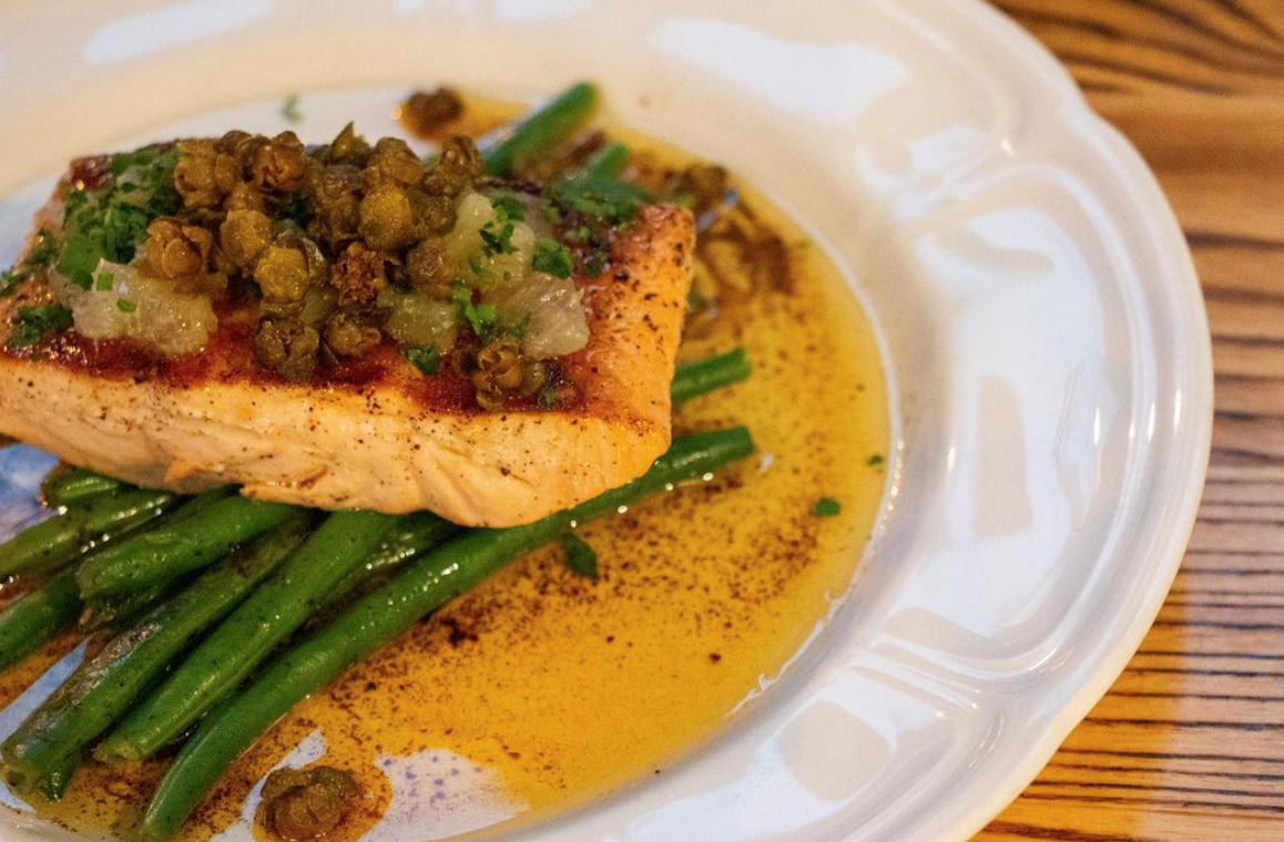 The Salmon entrée, a go-to dish for many Sacred Beast patrons