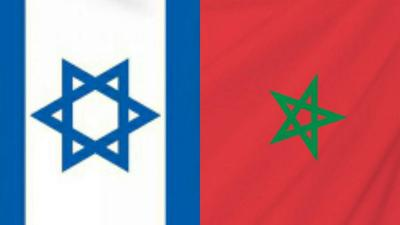 Courtesy of JNS The flags of Israel and Morocco.