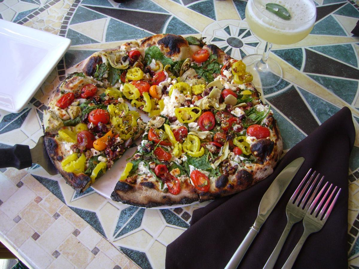 The Mediterranean pizza is loaded with topping to make it a delicious vegetarian pizza.