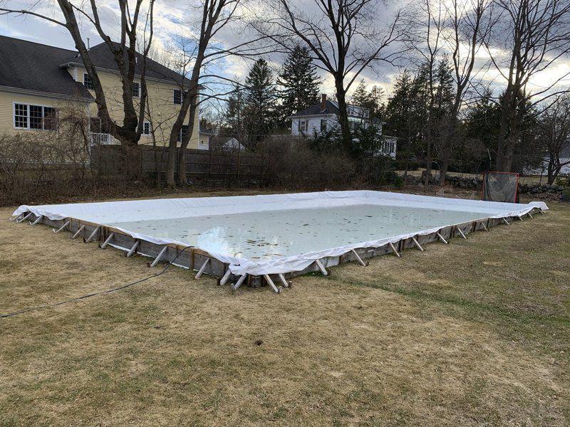 Frozen out; Warm winter leaves backyard rinks all wet