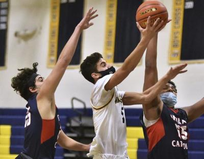 Once nearly cut from freshman team, Aruri now starting guard and captain for unbeaten boys hoops