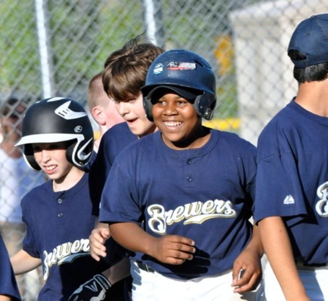 1eb721c88 Aneudy Moreno celebrates with teammates after connecting on the second of  his two home runs for the Brewers during the Andover Little League Majors  Division ...