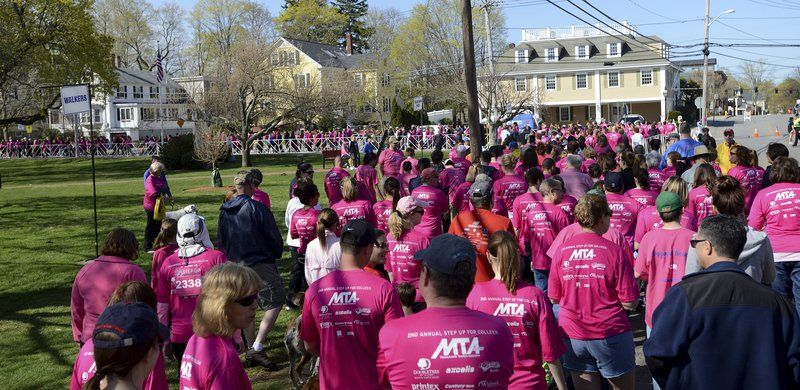 A race to remember; Thousands step up in a pink way to honor Ritzer's legacy