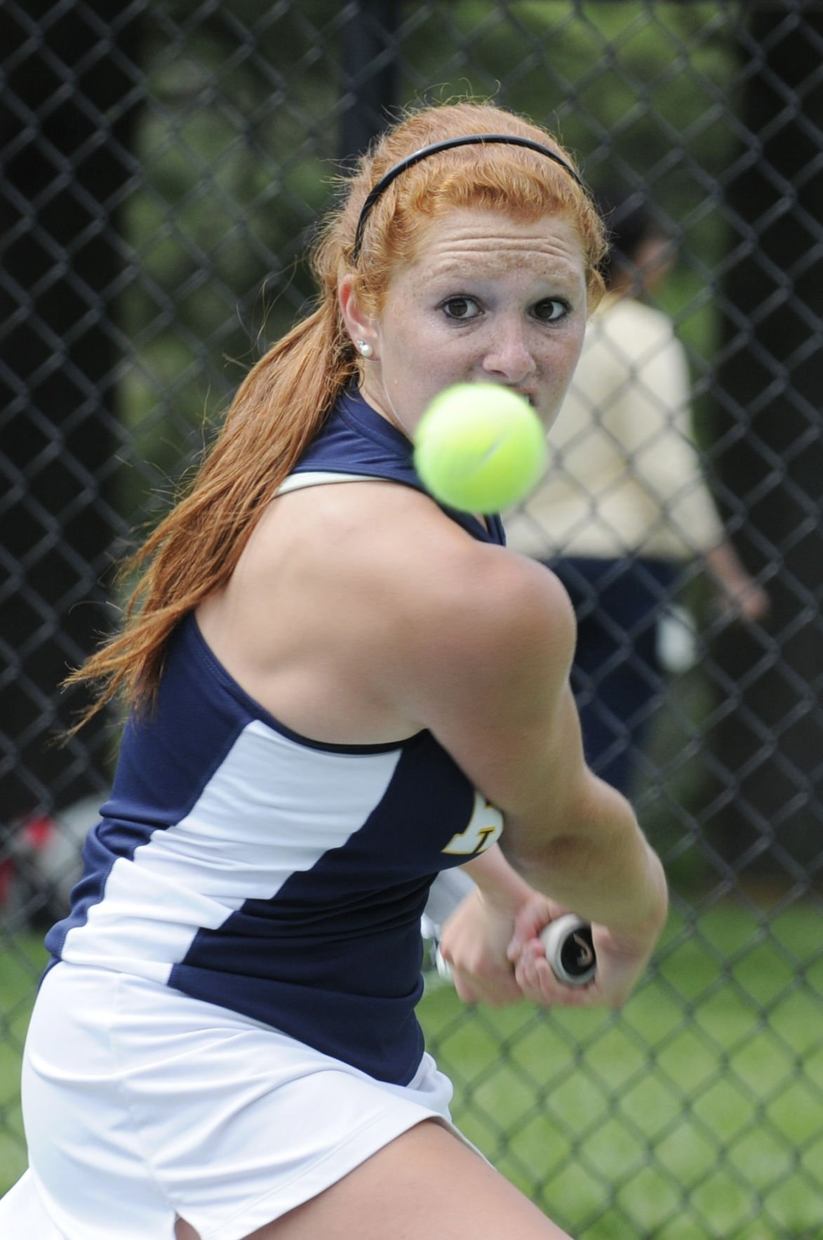 Andover's first singles Courtney Nash keeps her eye on the ball and returns a volley against Shrewsbury during the MIAA D1 State Final.