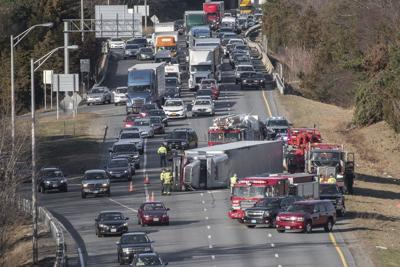 Tractor-trailer rollover snarls I-495 commute