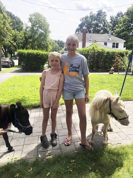 Mini-horse house call cheers young cancer patient