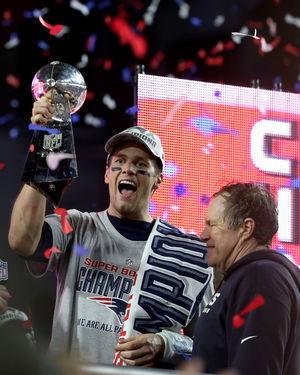 New England Patriots quarterback Tom Brady and head coach Bill Belichick celebrate after winning Super Bowl XLIX in Glendale, Ariz.