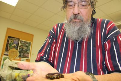 JSU biology professor Dr. George Cline holds a specimen.