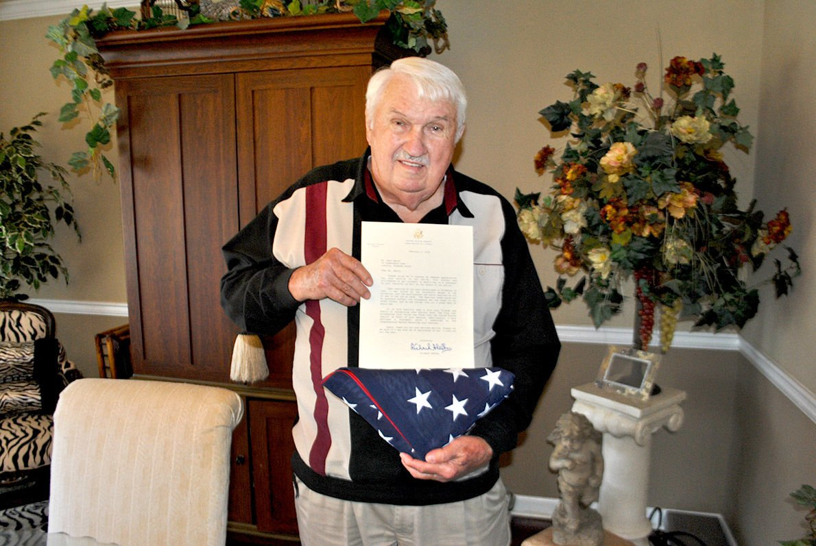 Earl Smith with flag that flew over U.S. Capitol in his honor