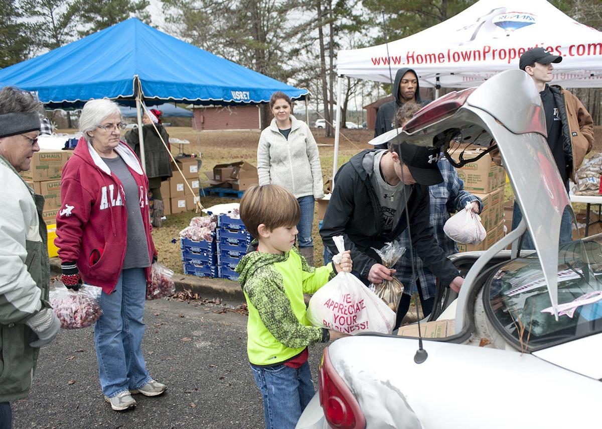 Dozens of volunteers assist with 6th annual Christian Love Pantry Christmas in the Park Food Giveaway (photo gallery)