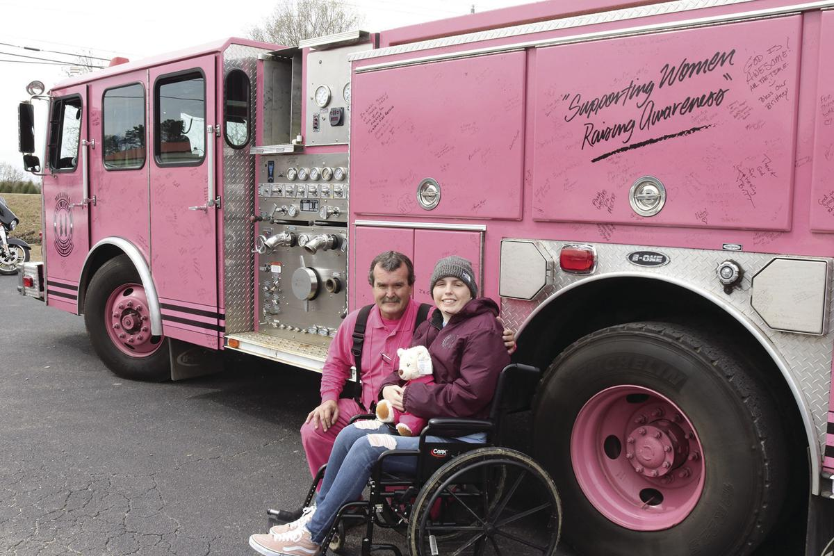 Brittany with the pink firetruck