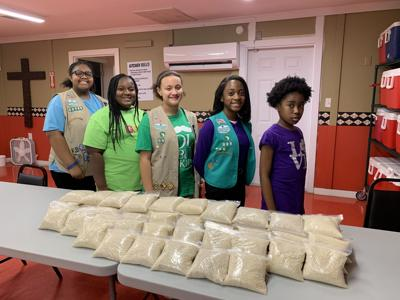 Girl Scouts from Troop 20099 in Talladega lend hand at Red Door Kitchen