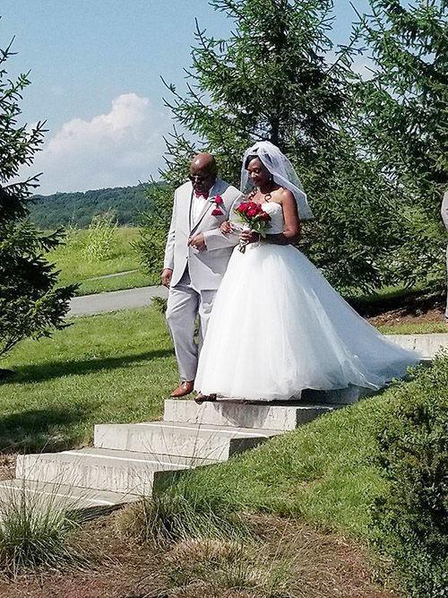 Bride Jeneen Cherie Stewart escorted by her father