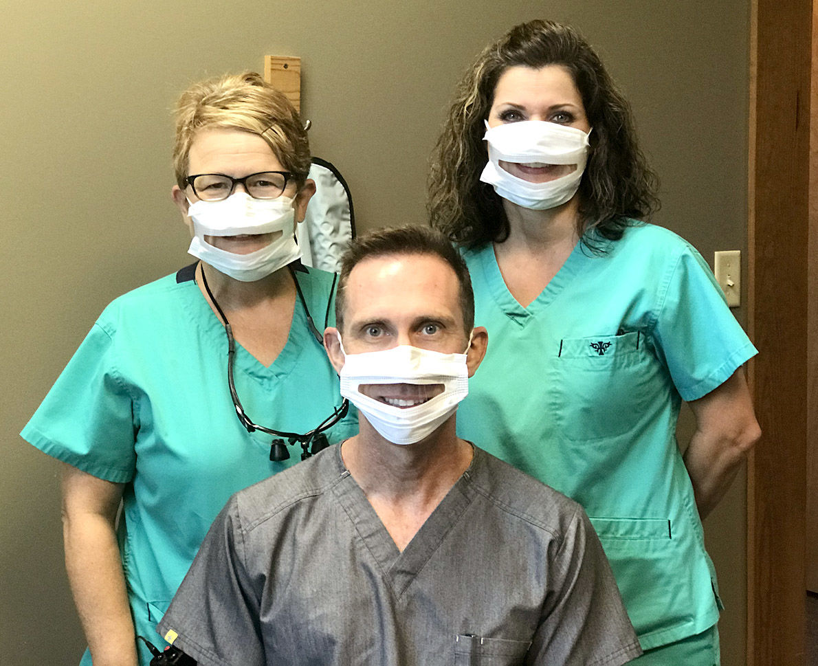 Talladega dentist Dr. Daniel Piccard using special mask to communicate with deaf patients