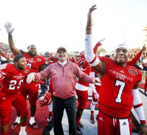 JSU head coach John Grass celebrates with quarterback Eli Jenkins and the rest of the Gamecocks after winning in overtime during the second round of the FCS playoffs Saturday on Burgess-Snow Field. Photo by Stephen Gross / The Anniston Star