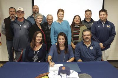 Madison Sanders signs scholarship